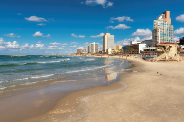 Tel Aviv beach with a view of Mediterranean sea and skyscrapers, Israel.