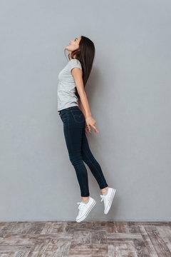 Vertical image of woman flying in studio