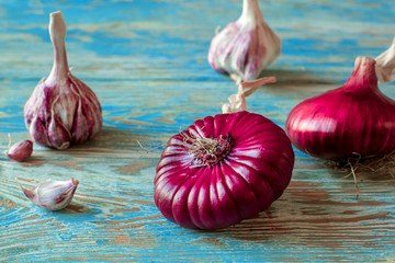 Image result for Garlic on blue wooden table