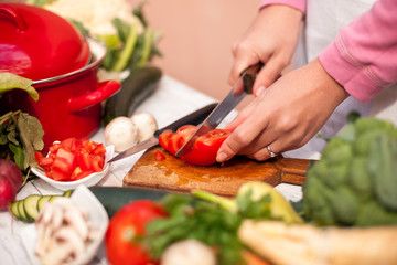 Vegetable cutting, woman cut tomato with a knife