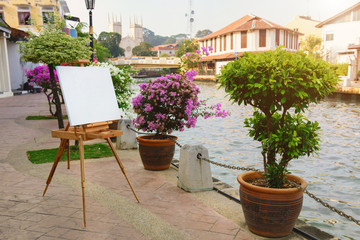 Empty easel for painting a picture of beautiful cityscape