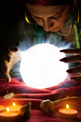Glowing crystal ball and fortune teller woman who predict future