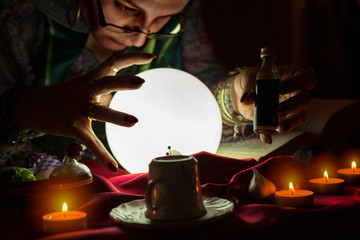Female fortune teller with love potion