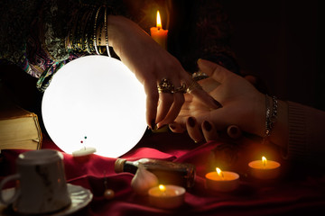 Fortune teller read a fortune from palm