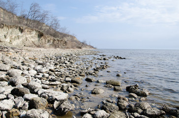 the rocky shore of the lake