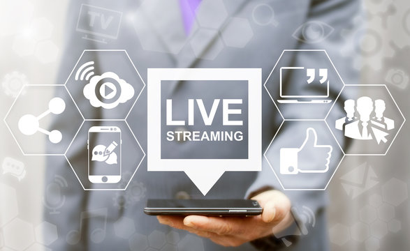 Live streaming social media web network concept. Man offers smart phone with bubble live streaming icon on virtual screen. Broadcast online technology stream video and music. Internet marketing.
