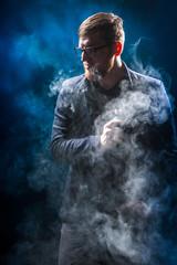 Smoking electronic cigarettes. Man in smoke