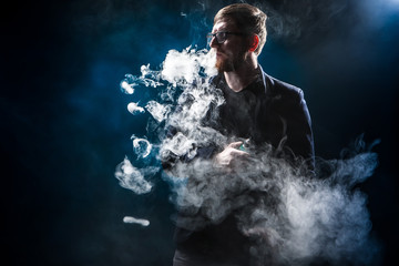The man releases rings of smoke.