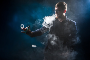 The man releases rings of smoke. Tricks with smoke.