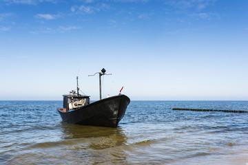 Fishing boat on the coast.