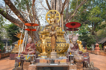 Small chedi surrounded by Buddha status at Wat Jed Yod, Chiang Mai, Thailand