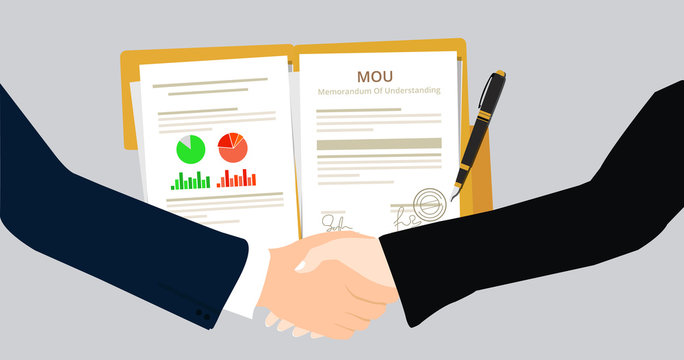 Businessman agreement to collaboration after the signature of the legal document MOU Memorandum Of Understanding
