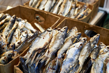 Dried fish in boxes on market