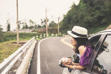 Asain woman traveler with hatchback car with beautiful mountain