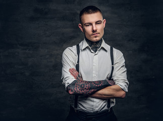 A man with a tattoo on his face and arms.