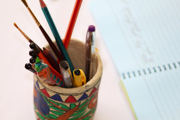 paper mache pencil stand with notepad in background
