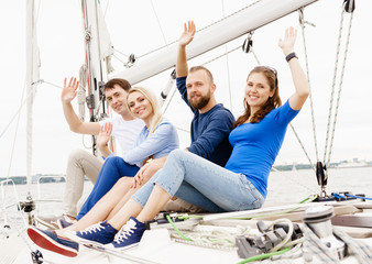 Group of happy friends traveling on a yacht. Tourism, vacation, holiday, concept.
