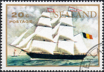 UKRAINE - CIRCA 2017: A stamp printed by Sealand, showsTwo-masted sailing ship under the flag of the Kingdom of Belgium floating on the sea, circa 1970