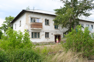 Brick two-story house built in the Soviet Union