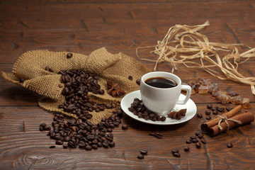 White cup of coffee with beans