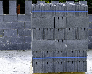 Stack of grey clay brick on pallet of a terace