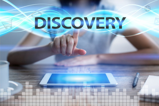 Woman using tablet pc, pressing on virtual screen and selecting discovery.