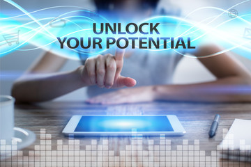 Woman using tablet pc, pressing on virtual screen and selecting unlock your potential.