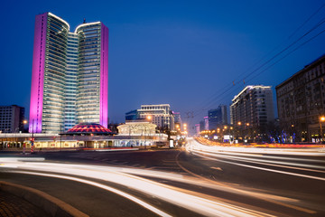 Blurred night traffic movement at the city center of Moscow, urban view with skyscraper and city illumination lights, outdoor travel background