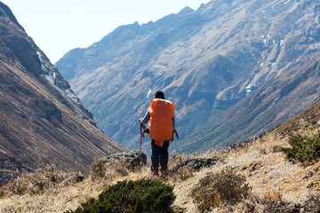 Silhouette of Human with Backpack overlooking Mountain Valley
