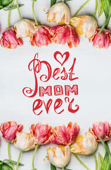 Mothers Day Greeting with text lettering, Lovely tulips with water drops, floral springtime frame, top view.