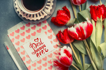 Mothers Day Greeting card with text lettering Best mom ever, hearts and pencil , pretty tulips and cup of coffee, top view.