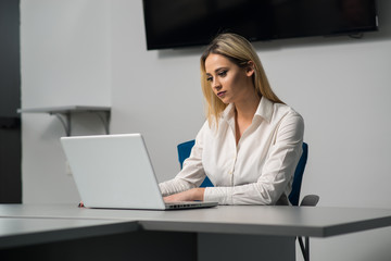 Young attractive female in business officce