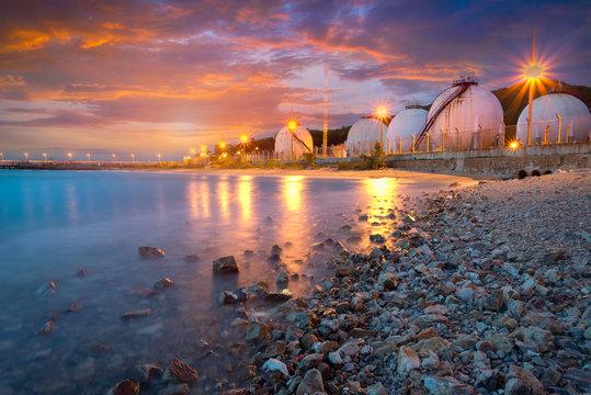 Natural Gas storage tanks , Oil tank , LPG , Petrochemical plant , Petroleum at sunset