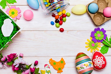 Colorful Easter decoration on wooden background. Happy Easter.