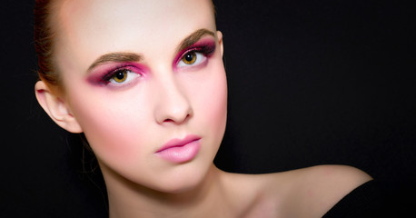 Beauty Fashion Model Girl with pink make-up, close-up studio shoot