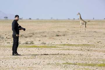 Photographer taking a picture of a giraffe