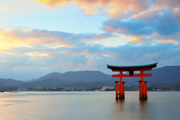 Great floating gate (O-Torii) on Miyajima island near Itsukushima shinto shrine with beautiful sunset
