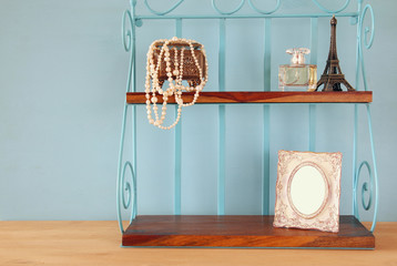 Classic shelf with vintage objects and blank frame