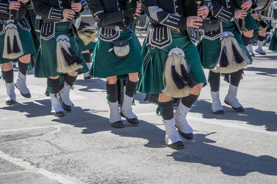 Closeup of green kilts of bagpipes players at 2017 St. Patrick's Day Parade in New York City