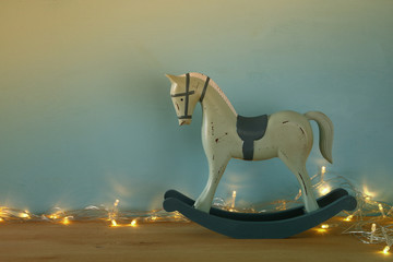 vintage rocking horse on wooden floor.