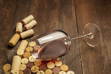 Glass of red wine and corks with place for text