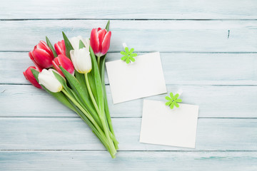 Fresh tulip flowers bouquet and photo frames