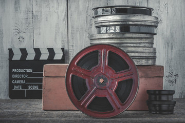 Clapperboard and the reel of film