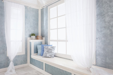 Bright interior, window with curtains, white window sill, room, home