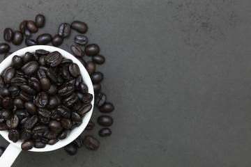 coffee beans on dark black background.