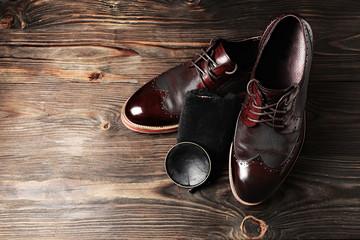 leather shoes on table with polishing equipment. Fashion handmade. Wax