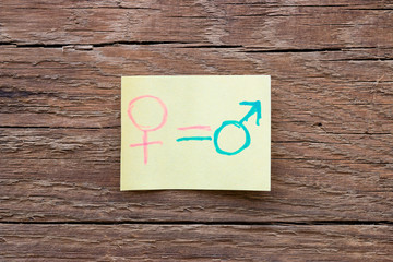 paper notes with gender symbols closeup