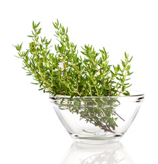 thyme in the glass bowl, on a white background