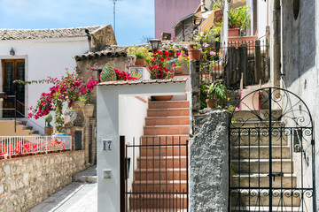 Courtyard with stairs and plants in Taormina at Sicilian Island