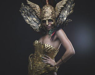 Latin woman with green hair and gold costume with handmade flourishes, fantasy image and tale